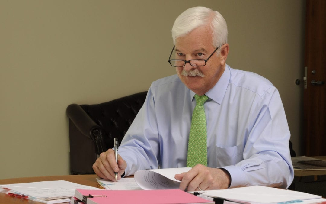 Auditor O'Brien working on papers.